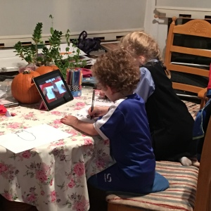 My kids sitting quietly - read on to find out how and why!